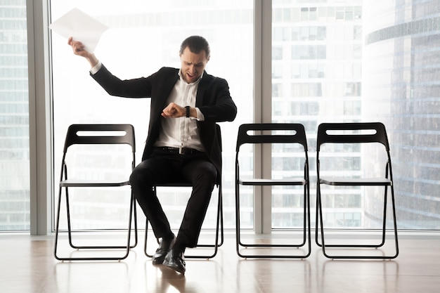Distraught impatient businessman yelling in anger Free Photo