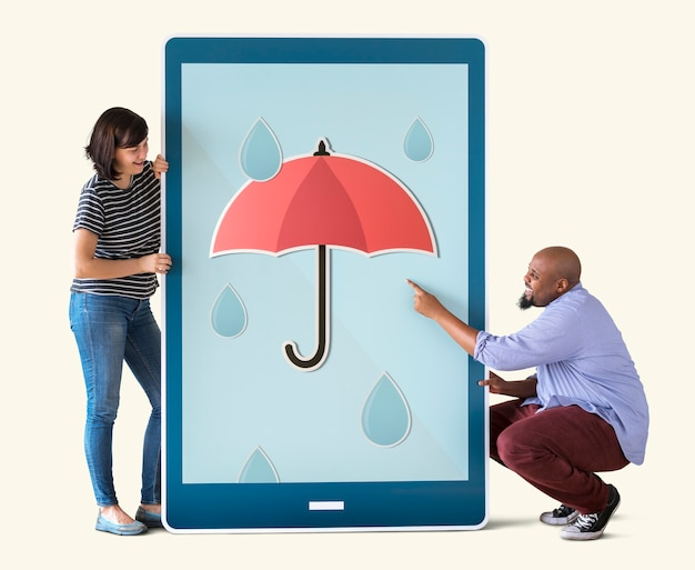 Diverse couple of people holding a tablet Premium Photo