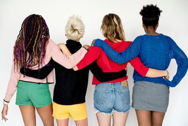 Diverse friends holding around each other Premium Photo