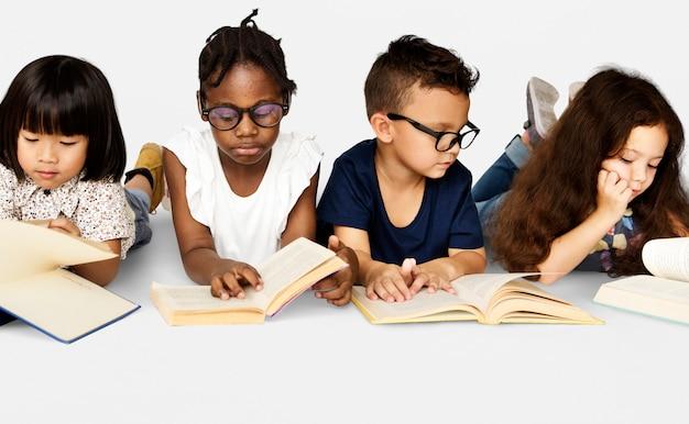 Diverse group of kids study read book Premium Photo