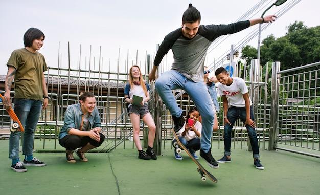 Diverse group people skateboard park concept Premium Photo