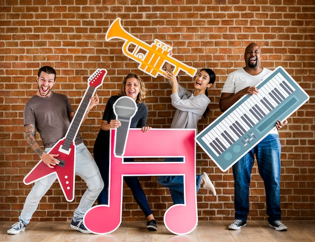 Diverse happy musicians playing together Premium Photo