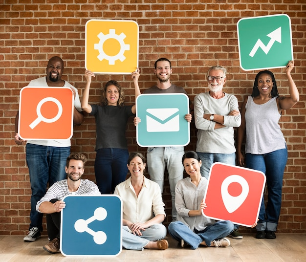 Diverse happy people with social networking icons Premium Photo