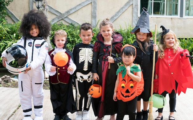 Diverse kids in halloween costumes Free Photo