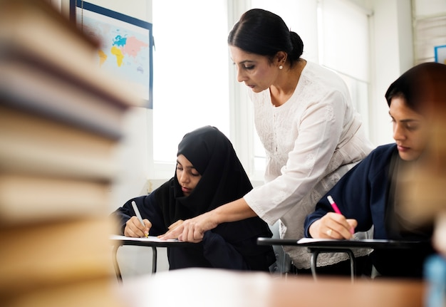Diverse muslim girls studying in classroom Premium Photo