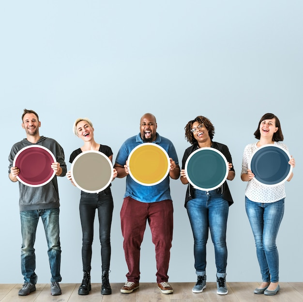 Diverse people holding blank round board Premium Photo