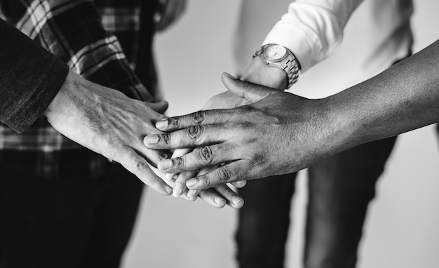 Diverse people joining hands together teamwork and community concept Free Photo
