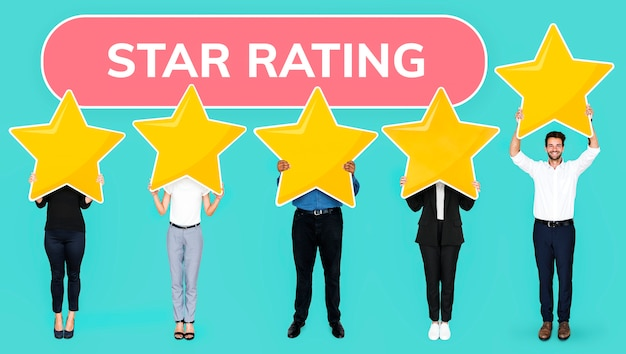 Diverse people showing golden star rating symbol Free Photo