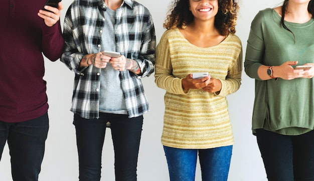 Diverse people standing with thier mobiles in hand Premium Photo