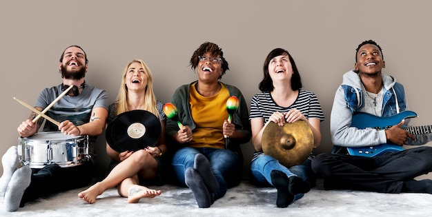 Diverse people with music instruments Free Photo