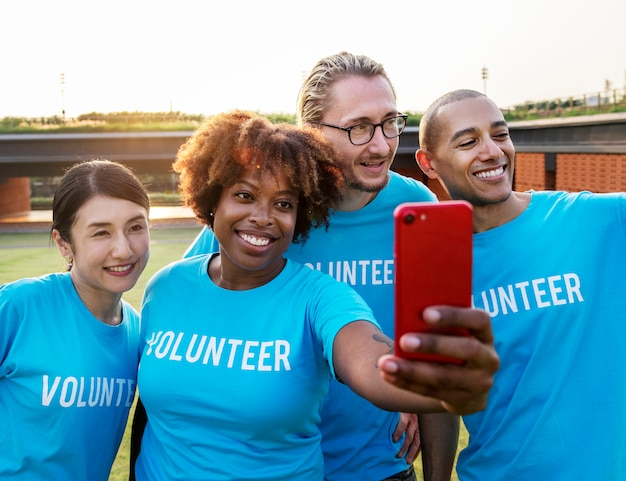 Diverse volunteers taking a selfie together Free Photo
