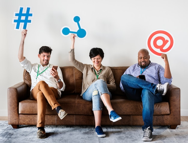 Diverse workers sitting on couch holding Premium Photo
