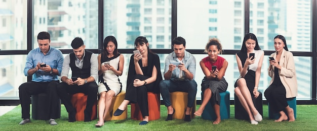 Diversity people group of multiethnic businessperson in casual suit using smart phone Premium Photo