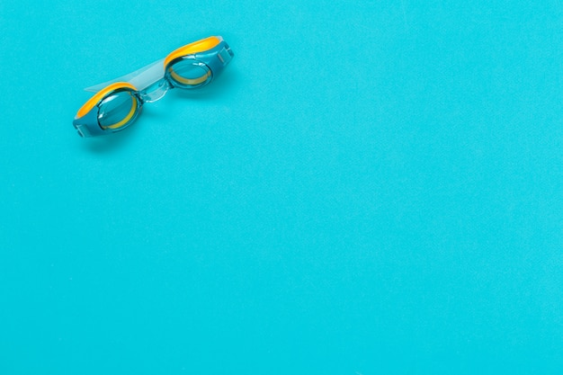 Diving goggles isolated on blue color background Premium Photo