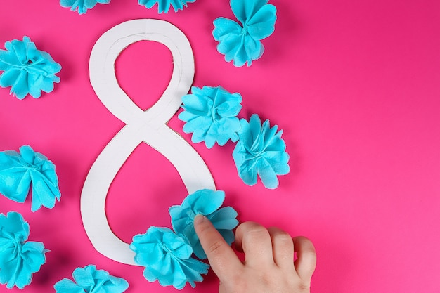 Diy eight made cardboard decorated artificial flower made blue tissue paper napkin pink background. Premium Photo
