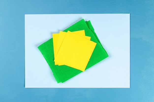 Diy greeting card with mimosa flowers paper balls for march 8 on blue background. Premium Photo