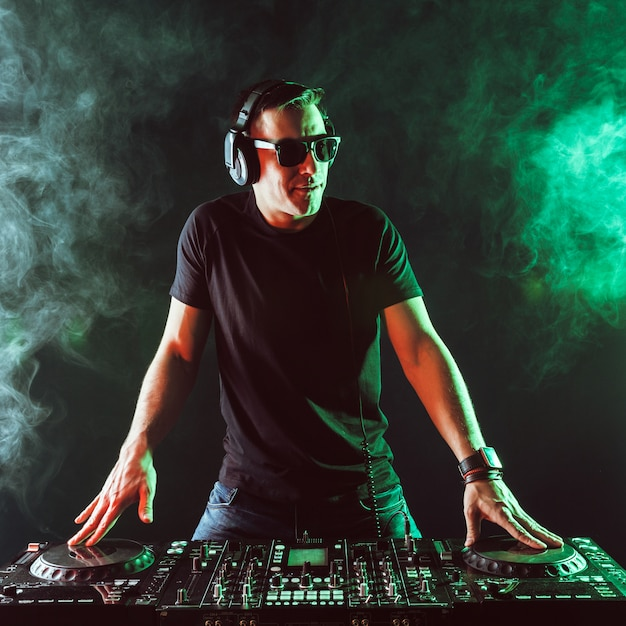 Dj mixing music on mixer Premium Photo