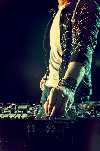 Dj playing music at mixer closeup Premium Photo