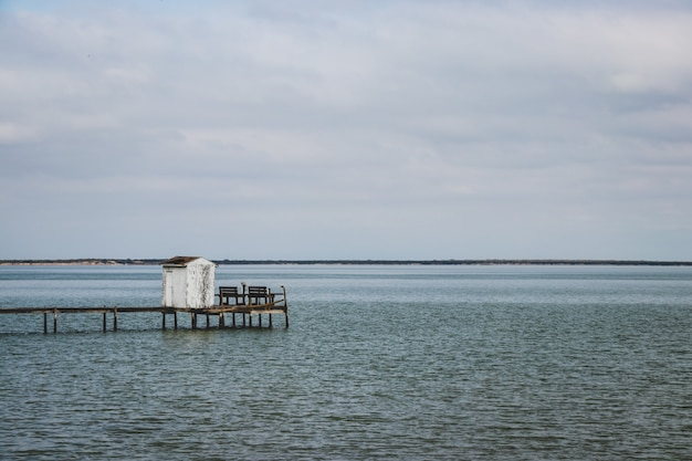 A dock leading to the ocean Premium Photo