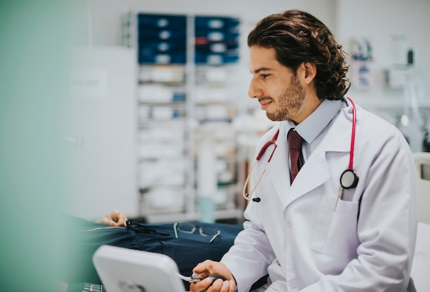 Doctor checking a patients blood pressure Premium Photo