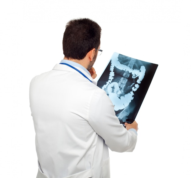 Doctor consulting a bowel radiography Premium Photo