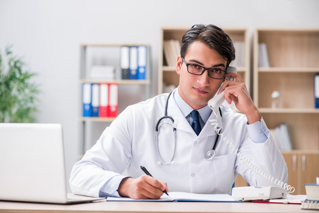 Doctor consulting patient over the phone Premium Photo