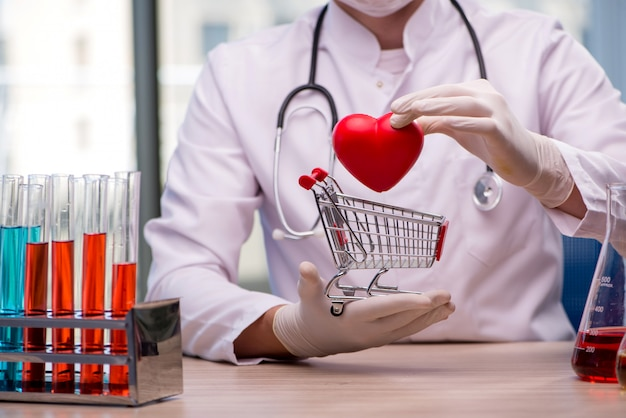 Doctor curing heart in medical concept Premium Photo
