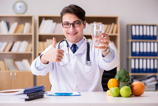 Doctor in dieting concept with fruits and vegetables Premium Photo