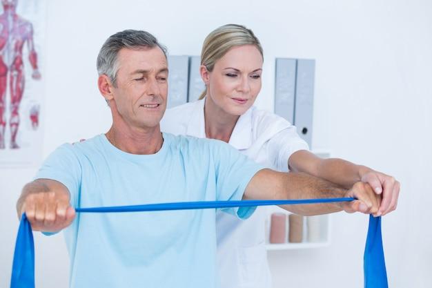 Doctor examining her patient back Premium Photo