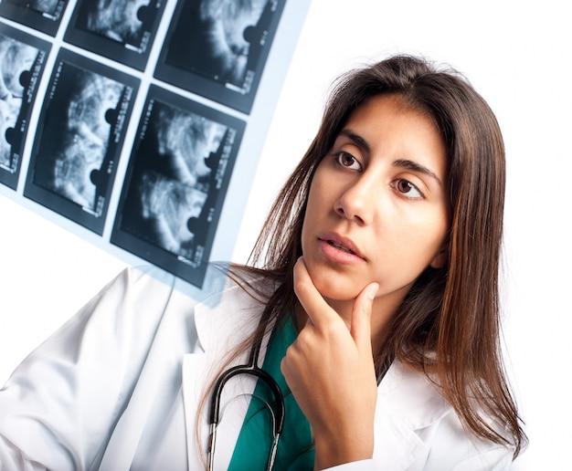 Doctor examining a mammogram Premium Photo
