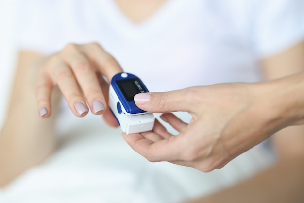 Doctor fixes heart rate monitor on finger. patient heart rate measurement concept Premium Photo