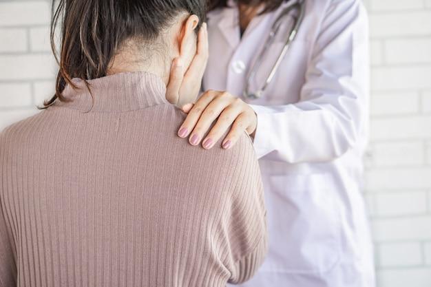 Doctor hand comforting stress female patient Premium Photo