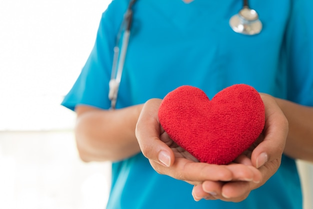 Doctor hands holding red heart. healthcare concept. Premium Photo