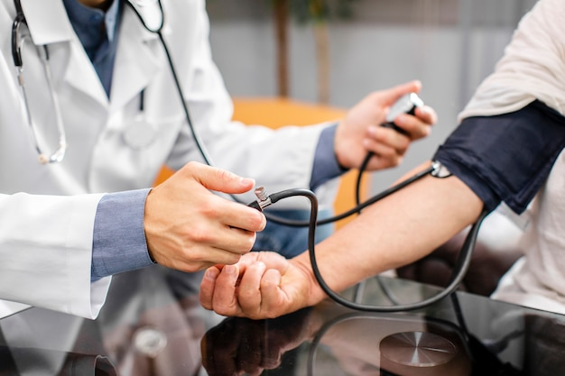 Doctor hands measuring tension to a patient Free Photo
