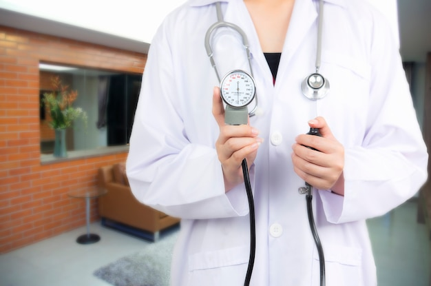 Doctor holding  on blurred patient in emergency room Premium Photo