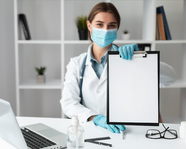 Doctor holding medical clipboard Free Photo