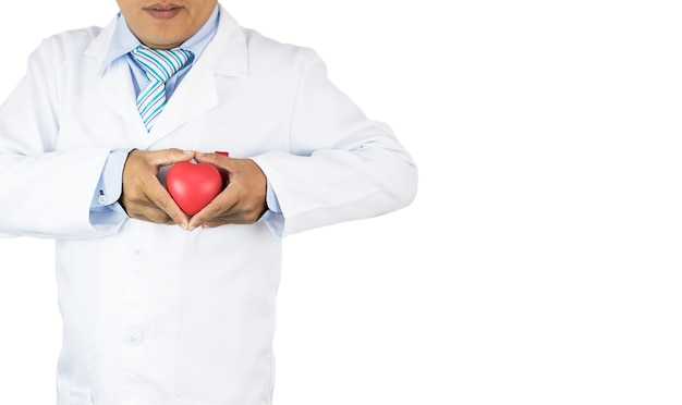 Doctor holding red heart isolated, prevent heart disease, copy space Premium Photo