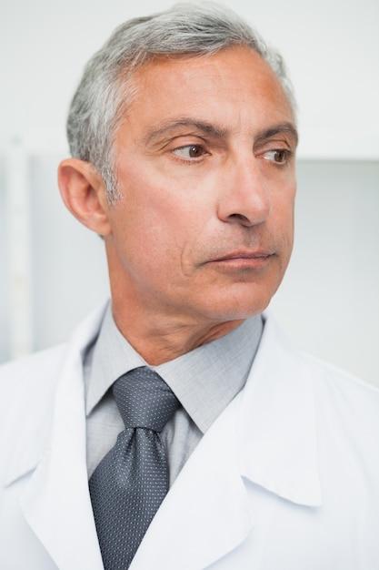 Doctor looking away Premium Photo