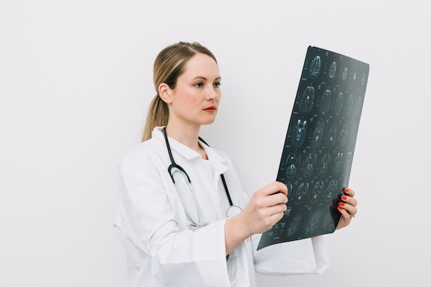 Doctor looking at x-ray picture Free Photo