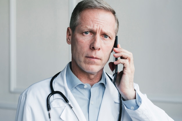 Doctor making a phone call Free Photo