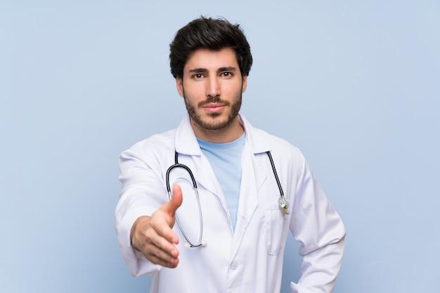 Doctor man handshaking after good deal Premium Photo