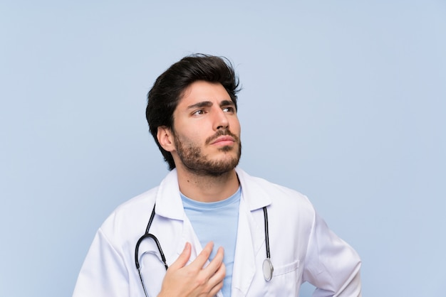 Doctor man standing and thinking an idea Premium Photo