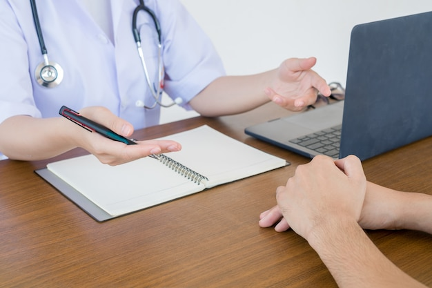 Doctor physician consulting with male patients in hospital exam room. men's health concept Premium Photo
