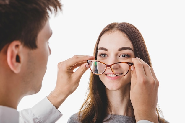 Doctor putting glasses on woman Free Photo