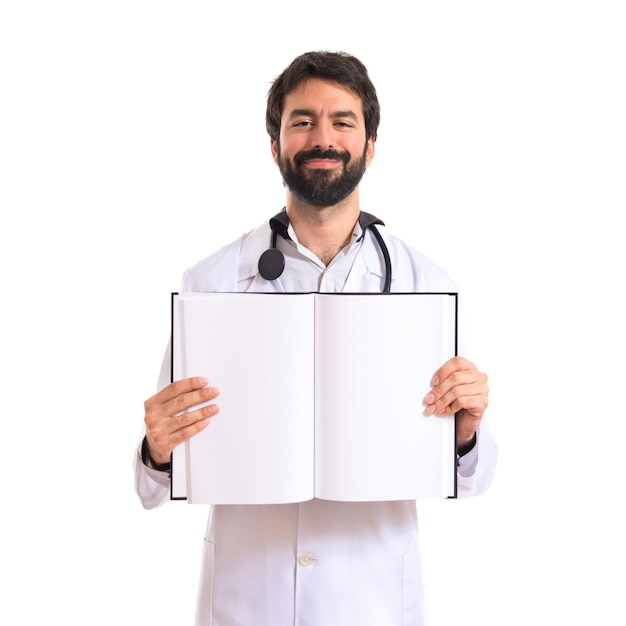 Doctor reading a book over white background Free Photo