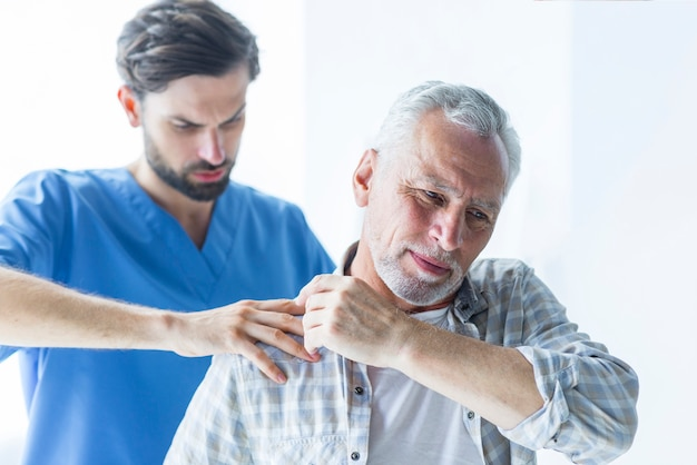 Doctor rubbing shoulder patient 23 2147896872