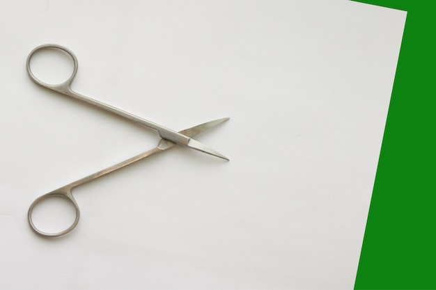 Doctor scissors  on white green Premium Photo