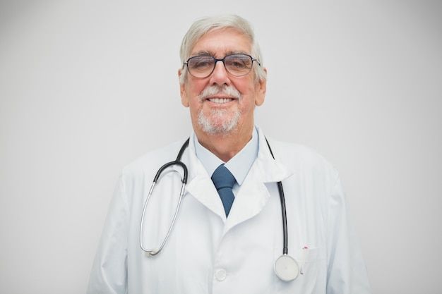 Doctor smiling into the camera Premium Photo