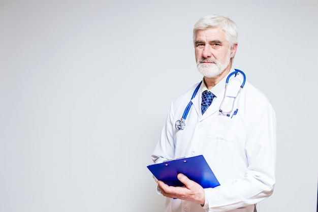 Doctor standing with a folder and a stethoscope Free Photo