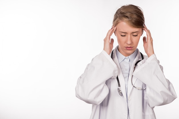 Doctor stressed - migraine and headache people. health care prof Free Photo